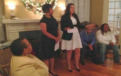 Kelly Durden, left standing, and Sarah Demarest, right standing, discuss the work of the LGBTQ Law Center, with Freedom Center for Social Justice founder Bishop Tonyia Rawls seated left.