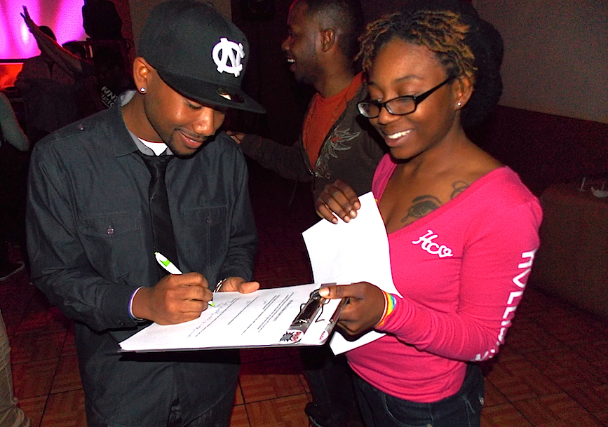 A Charlotte LGBT center volunteer worked the crowd to sign up new center supporters.