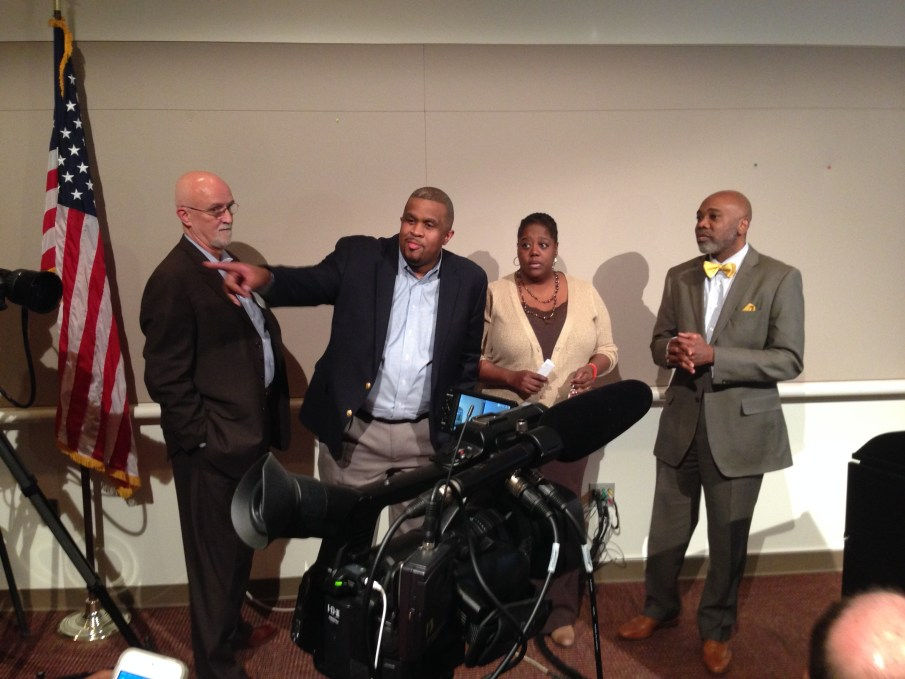 Charlotte Councilmembers (L-R) John Autry, David Howard, LaWana Mayfield and Al Austin await other members of Council for the Wednesday press conference following now-former Mayor Patrick Cannon's arrest. Given the right circumstances, Mayfield and Austin could be joined by a third openly gay Council member when the body chooses the next mayor.