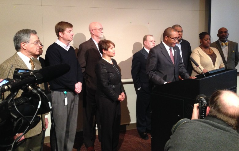 Charlotte City Councilmember and Mayor Pro Tem Michael Barnes is joined by other Council members and City Manager Ron Carlee during a press conference Wednesday.