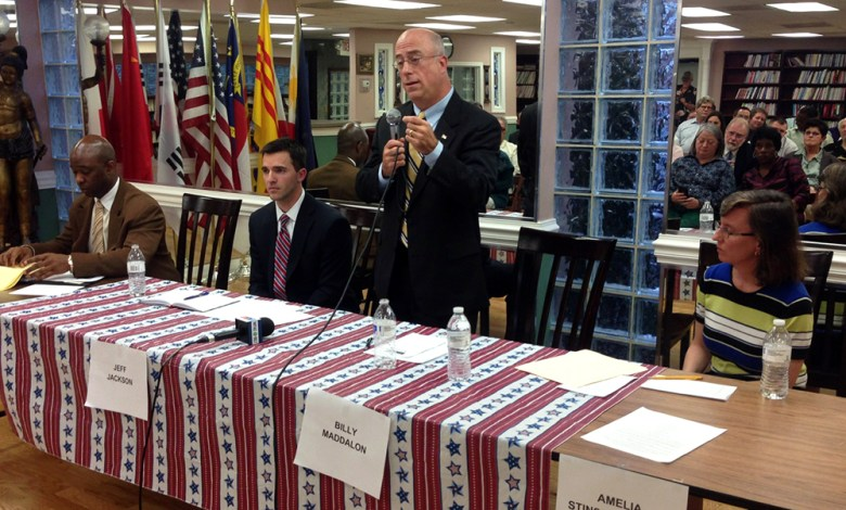 Billy Maddalon (standing) speaks at a forum with three other candidates vying for a vacant state Senate seat (L-R): Darrell Bonapart, Jeff Jackson and Amelia Stinson-Wesley.