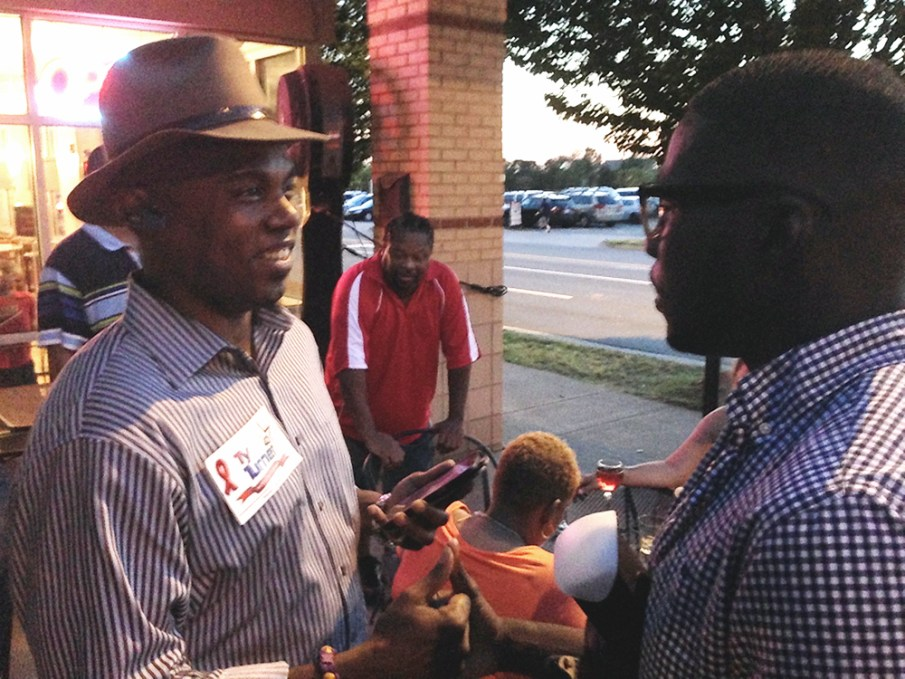Openly gay state Senate candidate Ty Turner, who lost in his primary on Tuesday, chats about the results with his brother, Stephen Graddick, at their election watch party in Uptown Charlotte.