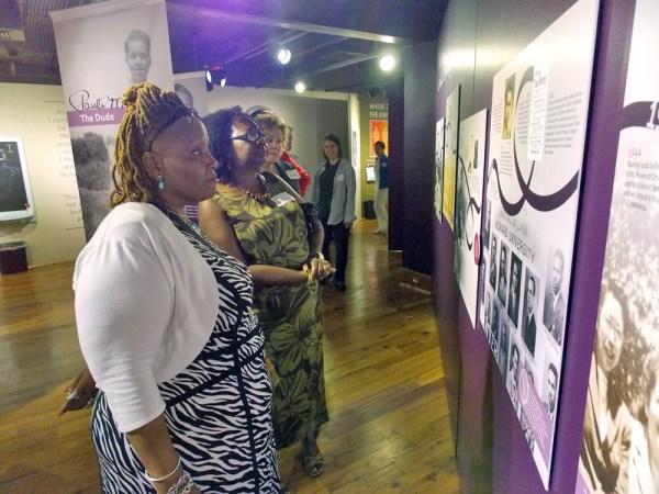 Visitors view the Pauli Murray exhibit.