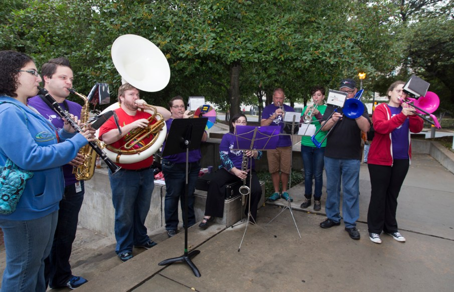 """Members of the Charlotte Pride Band serenaded happy couples as they existed the Mecklenburg Register of Deeds office. The band played a medley of """"Going to the Chapel of Love"""" and Felx Mendelssohn's traditional """"Wedding March."""" Photo Credit: Jennifer Hogan (hoganimaging.com)"""