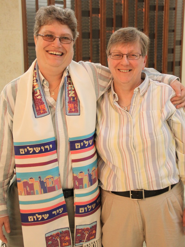 Kim Pearl and Karen Millman met when they both worked at Winn-Dixie in December 1997. Seven years later, the couple had marked their relationship with a blessing at Temple Beth El. And, on Oct. 17, they were finally able to make it official with a fully legal wedding at the temple, performed under the same chupah (canopy) they'd had made for their commitment ceremony a decade ago. (L.M.) Photo Credit: Wendy Thiesen-Halsey