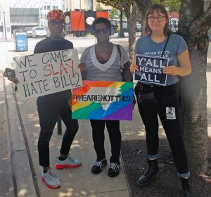 LGBT and allied community members protested HB2 outside The Westin Hotel on June 24 during the gubernatorial debate between Gov. Pat McCrory and Attorney General Roy Cooper.