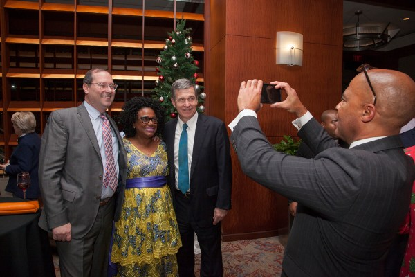 Gov. Roy Cooper in a photo op moment with attendees