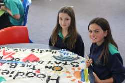 Painting the banners was a highlight with students taking turns to add important 'Save the Hoodie' messages on the banners.