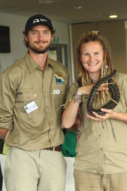 Pete Crowcroft and Rachel Beecham holding a python