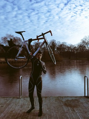Greg James wetsuit holding up bike