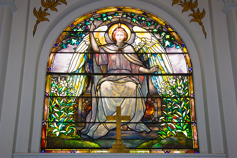 The stain glass window on the alter of the Reformed Church in the historic Port Richmond section of Staten Island, N,Y. on Friday Oct. 25, 2013. The glass may have been made by Louis Comfort Tiffany, but is unsigned and authentication would cost $1500.00. (Gordon Donovan)
