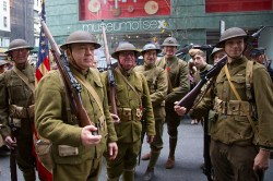 People dressed as doughboys (WWI infantrymen) get ready for the Veterans Day parade on Fifth Avenue in New York on Nov. 11, 2014. The Dough Boys are members of several armed forces who were wearing World War II uniforms to honor the 100th anniversary of the start of the war. (Gordon Donovan)