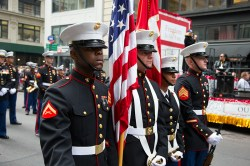 Members of the United States Marine Corp pause while marching during the Veterans Day parade on Fifth Avenue in New York on Nov. 11, 2014. (Gordon Donovan/)