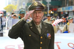 "Veteran Jerry Yellin salutes as he leads the ""The Spirit of 45"" during the Veterans Day parade up Fifth Avenue in New York on Nov. 11, 2014. (Gordon Donovan)"