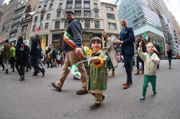 Children wave to the crowds while marching up Fifth Ave. during the St. Patrick's Day Parade, March 17, 2015, in New York. (Gordon Donovan)