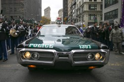 An old NYPD squad car moves its way through the crowd before the start of the Veterans Day parade on Fifth Avenue. (Gordon Donovan)