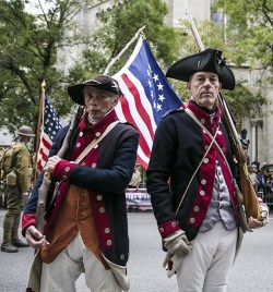 People dressed as soldiers from the American Revolutionary War pose for a photo during the Veterans Day parade on Fifth Avenue in New York on Fifth Avenue in New York on Nov. 11, 2015. (Gordon Donovan)