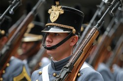 A cadet from the U.S. Military Academy at West Point marches during the Veterans Day parade. (Gordon Donovan)