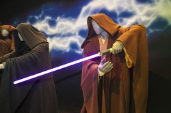 The costume of the Jedi had an immediate effect on the actors who wore them, and influenced their portrayals. The success of the lightsaber, the signature weapon of the Jedi and Sith, is achieved through the combination of cutting-edge sound and visual effects, the actor's extensive sword training and careful choreography. (Gordon Donovan/Yahoo News)