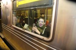 A passengers on the subway takes a photo of people wearing no pants on the train platform in the No Pants Subway Ride in New York City, Sunday, Jan. 10, 2016. (Gordon Donovan/Yahoo News)