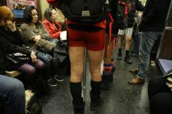 Passengers try to block out people take art taking part in the No Pants Subway Ride in New York City, Sunday, Jan. 10, 2016. The 'No Pants Subway Ride' is an annual event that has become a global celebration of bare thighs. The 'celebration of silliness' is designed to make other subway riders smile. (Gordon Donovan/Yahoo News)