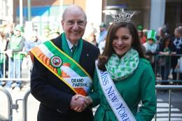 Grand Marshal of the 2016 NYC St. Patrick's Day Parade, Senator George J. Mitchell shakes hands with Miss New York, Jamie Lynn Macchia before the start of the St. Patrick's Day Parade, March 17, 2016, in New York. (Gordon Donovan/Yahoo News)