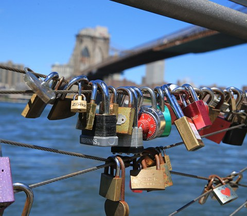 Lovers who have sealed the deal by throwing keys into the East River near the Brooklyn Bridge leave their love locks behind on August 23, 2016, as symbolic gestures. (Gordon Donovan/Yahoo News)