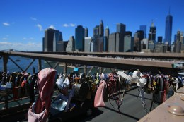Along with the love padlocks attached to light posts on the Brooklyn Bridge, clothing and headphones, seen here on August 23, 2016, are also sometimes left behind. (Gordon Donovan/Yahoo News)