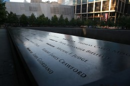The panels with the names of victims from the September 11, 2001 attacks are reflected by the morning light on Sept. 8, 2016.(Gordon Donovan/Yahoo News)