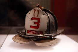 "The description that reads along side Pat Brown's helmet in the 9/11 Memorial and Museum, ""Responding on 9/11, Ladder Company 3, Captain Patrick ""Paddy"" Brown wore a different helmet than one he had left in the trunk of his car. It was this unworn helmet, recently relined, that served as Brown's surrogate at a memorial service held in St. Patrick's Cathedral on November 9, 2001, the date that would have been his 49th birthday."" (Photo: Gordon Donovan/Yahoo News)"
