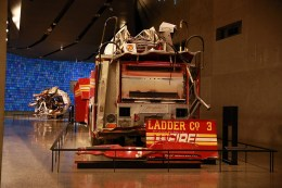 "The rear mount aerial truck was parked on West Street near Vesey Street. When the North Tower collapsed, the truck was damaged beyond repair, with its entire front cab destroyed. A bumper and back door panel were later removed from the rig and placed on display as a memorial in Ladder Company 3's quarters on East 13th Street in Manhattan. The inscription ""Jeff We Will Not Forget You!"" was painted on the panel by a firefighter related to Jeffrey John Giordano, one of the 11 Ladder Company 3 members who perished that day. (Photo: Gordon Donovan/Yahoo News)"
