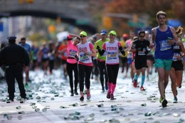 Two sisters run together up First Ave. just past mile 16 of the 2016 New York City Marathon, Nov. 6, 2016. (Gordon Donovan/Yahoo News)