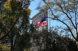 A U.S. flag flies over Madison Square Park during a ceremony honoring veterans in New York City on Nov. 11, 2016. (Gordon Donovan)