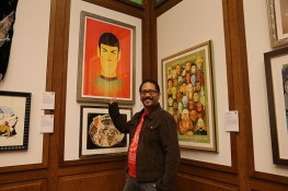 "Stanley Chow gestures towards his work ""Teleportation of Mr. Spock."" Chow is an illustrator, artist and graphic designer who hails fom the North of England. He is known for his portraits, particulary of pop-culture figures, and his clients include Saatchi and Saatchi and McDonald's. (Photo: Gordon Donovan/Yahoo News)"
