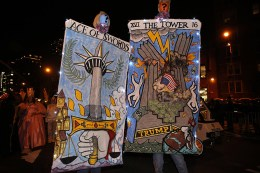 A couple visiting from Seattle participate with his and hers walking campaign cards for 2016 elections during the 43rd annual Village Halloween Parade in New York City on Oct. 31, 2016. (Gordon Donovan/Yahoo News)