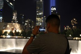 A visitor takes a photo of the Tribute in Light at the National September 11 Memorial & Museum on Sept. 10, 2016. (Gordon Donovan/Yahoo News)