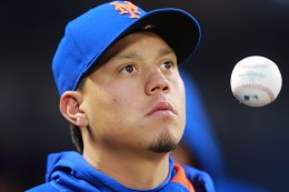 New York Mets Wilmer Flores stays loose in the dugout during a baseball game against the San Francisco Giants at Citi Field in New York, Friday, April 29, 2016. (Gordon Donovan)