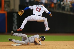 New York Mets shortstop Asdrubal Cabrera (13) goes airborne over Miami Marlins Derek Dietrich (32) for the double play in the ninth inning at Citi Field in New York, Monday, July 4, 2016. The Mets won 8-6. (Gordon Donovan)