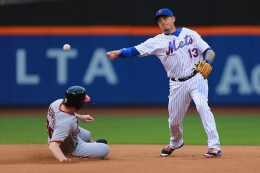New York Mets shortstop Asdubral Cabrera (13) fires a throw to complete the double play in the third inning of a baseball game against the Washington Nationals at Citi Field in New York, Thursday, July 7, 2016. (Gordon Donovan)