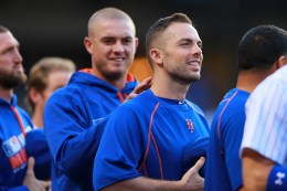New York Mets captain David Wright stands for the National Anthem as Addison Reed checks for on switch before the baseball game against the Arizona Diamondbacks at Citi Field in New York, Tuesday, Aug. 9, 2016. (Gordon Donovan)