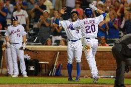 New York Mets Neil Walker (20) is congratulated at home plate by Curtis Granderson (3) after homering in the sixth inning of a baseball game against the Arizona Diamondbacks at Citi Field in New York, Tuesday, Aug. 9, 2016. (Gordon Donovan)