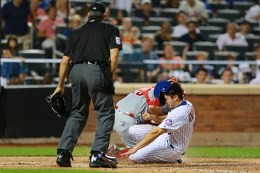New York Mets Travis d'Arnaud (18) is thrown out at the plate in the sixth inning of a baseball game against the Philadelphia Phillies at Citi Field in New York, Friday, Aug. 26, 2016. (Gordon Donovan)
