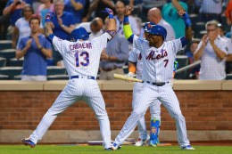 New York Mets Asdrubal Cabrera (13) and Jose Reyes (7) celebrate Cabrera's first inning home run against the Miami Marlins at Citi Field in New York, Tuesday, August 30, 2016. (Gordon Donovan)