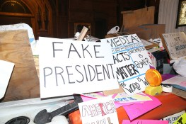 Discarded signs from Women's March sit in pile near a construction in New York City on Jan. 21, 2017. (Gordon Donovan/Yahoo News)