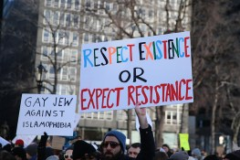 People hold up signs as they gather for a rally in New York's Battery Park in New York, Jan. 29, 2017, protesting President Donald Trump's immigration order. (Gordon Donovan/Yahoo News)