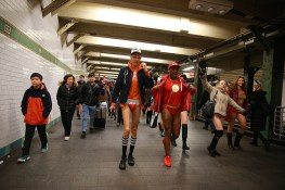 Participants of the No Pants Subway Ride head towards a connecting train in New York City, Sunday, Jan. 8, 2017. The 'No Pants Subway Ride' is an annual event that has become a global celebration of bare thighs. The 'celebration of silliness' is designed to make other subway riders smile. (Gordon Donovan/Yahoo News)