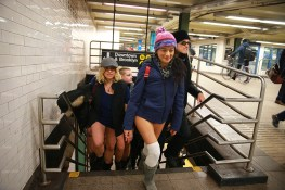 Participants of the No Pants Subway Ride arrive in Union Square Station in New York City, Sunday, Jan. 8, 2017. The 'No Pants Subway Ride' is an annual event that has become a global celebration of bare thighs. The 'celebration of silliness' is designed to make other subway riders smile. (Gordon Donovan/Yahoo News)