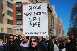 "A demonstrator holds up a sign during the ""Not My President's Day"" rally at Central Park West in New York City on Feb. 20, 2017. (Gordon Donovan/Yahoo News)"