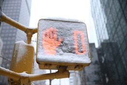 A walk sign is down to zero is covered in snow on Park Avenue in New York City during a winter storm on Feb. 9, 2017. (Gordon Donovan/Yahoo News)
