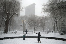 People enjoy the snow in Madison Square Park during a winter storm on Feb. 9, 2017, in New York. (Gordon Donovan/Yahoo News)